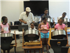 Wilton Dubois leading children in play drums