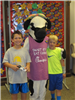 Boys standing with Cow