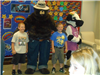 Children standing with Smokey the Bear