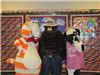 Fat Cat, Smokey Bear, and Cow standing together