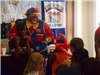 Girl assisting clown with presentation