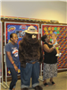 People standing with Smokey the Bear