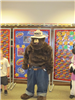 Smokey the Bear standing by boards