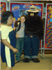 Woman and boy standing with Smokey the Bear