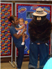 Woman and child standing with Smokey the Bear