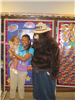Woman and child with Smokey the Bear