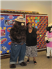 Woman with Smokey the Bear