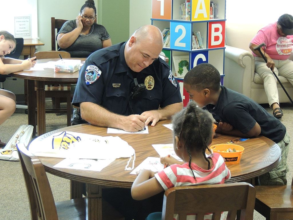 Coloring with the kids Even our Police officers take the time out to color with the kids