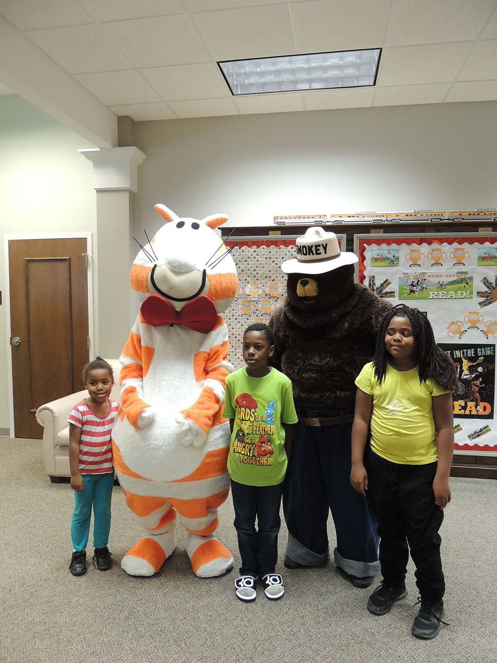 Fat Cat with Smokey the Bear and children