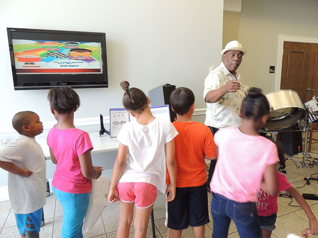 Kids enjoy watching Wilton play the steel drums during our Summer Reading Kickoff
