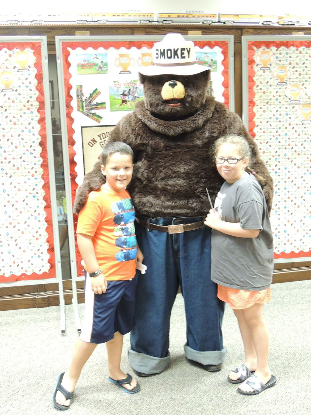 Smokey the Bear with boy and girl