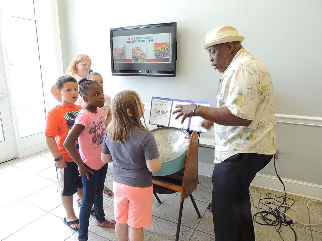 Wilton Dubois  teaches the kids how to play the steel drum