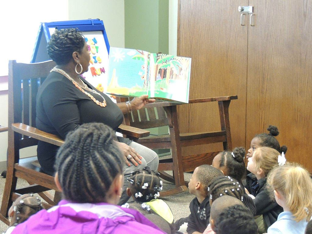Woman reading to seated children
