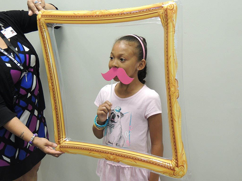 Girl hold mustache in frame