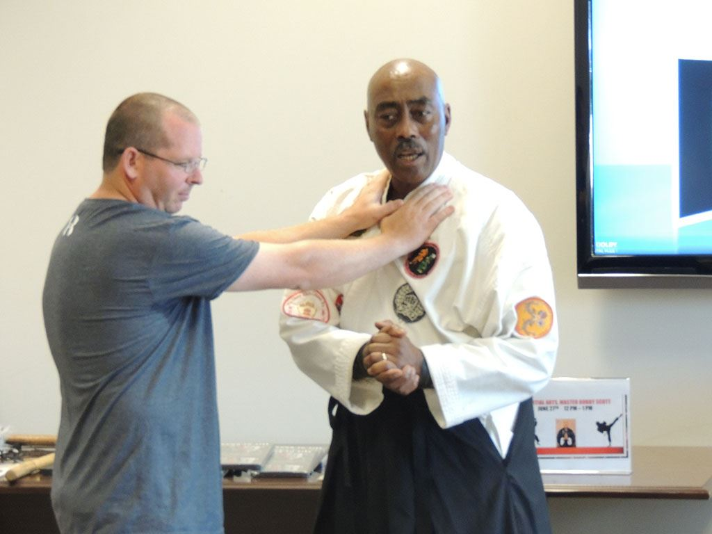 Man putting his hands on Master Bobby Scott