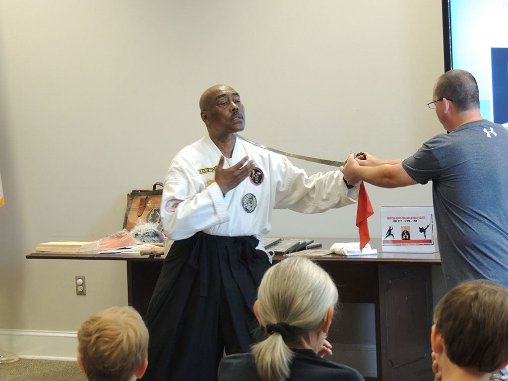 Master Bobby Scott demonstrating with sword