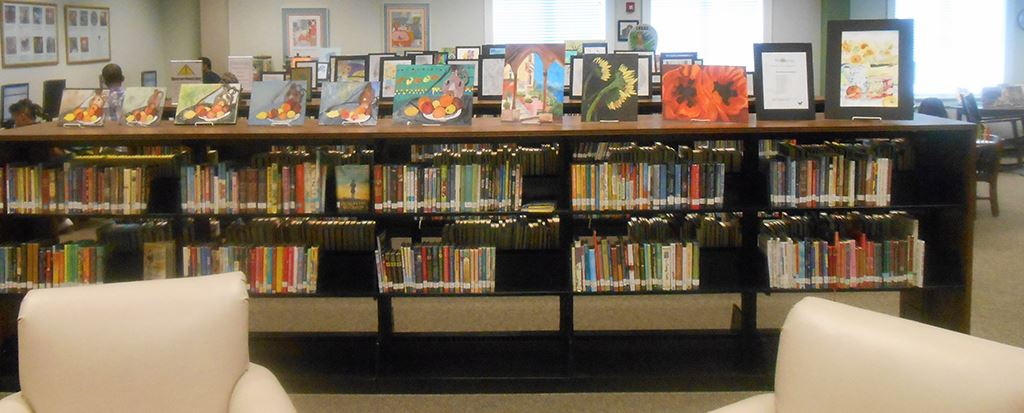 Book shelves displaying artwork