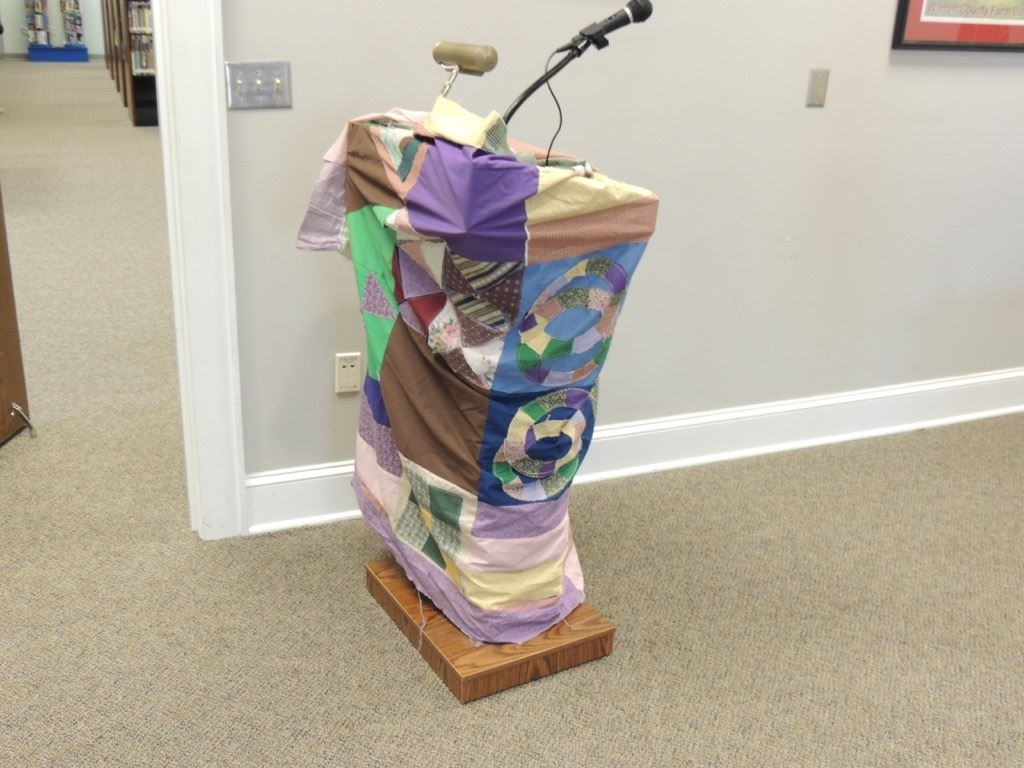 Quilt wrapped around podium