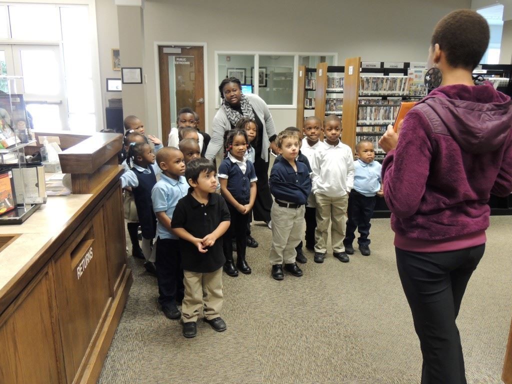 Children standing in Library