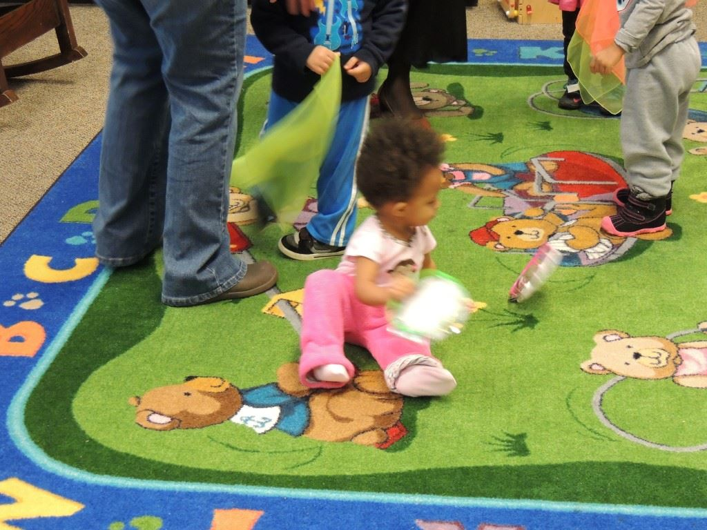 Toddler girl on play mat