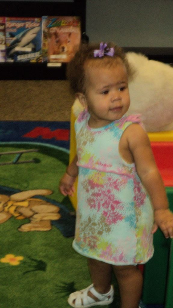 Toddler standing on play mat
