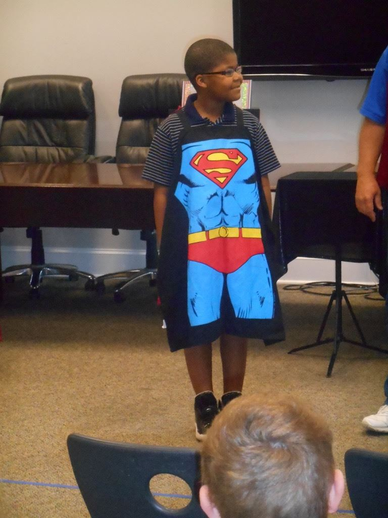 Boy wearing Superman apron