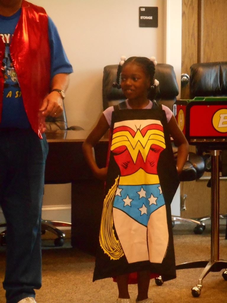 Girl wearing Wonder Woman apron