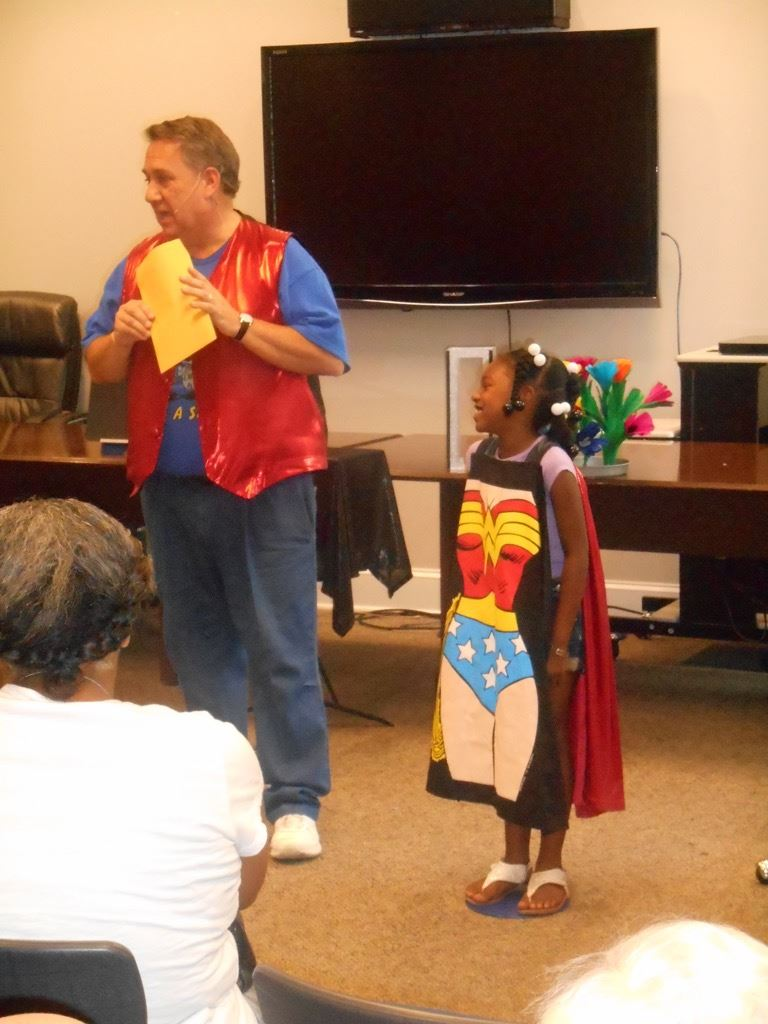 Steve with girl wearing Wonder Woman apron
