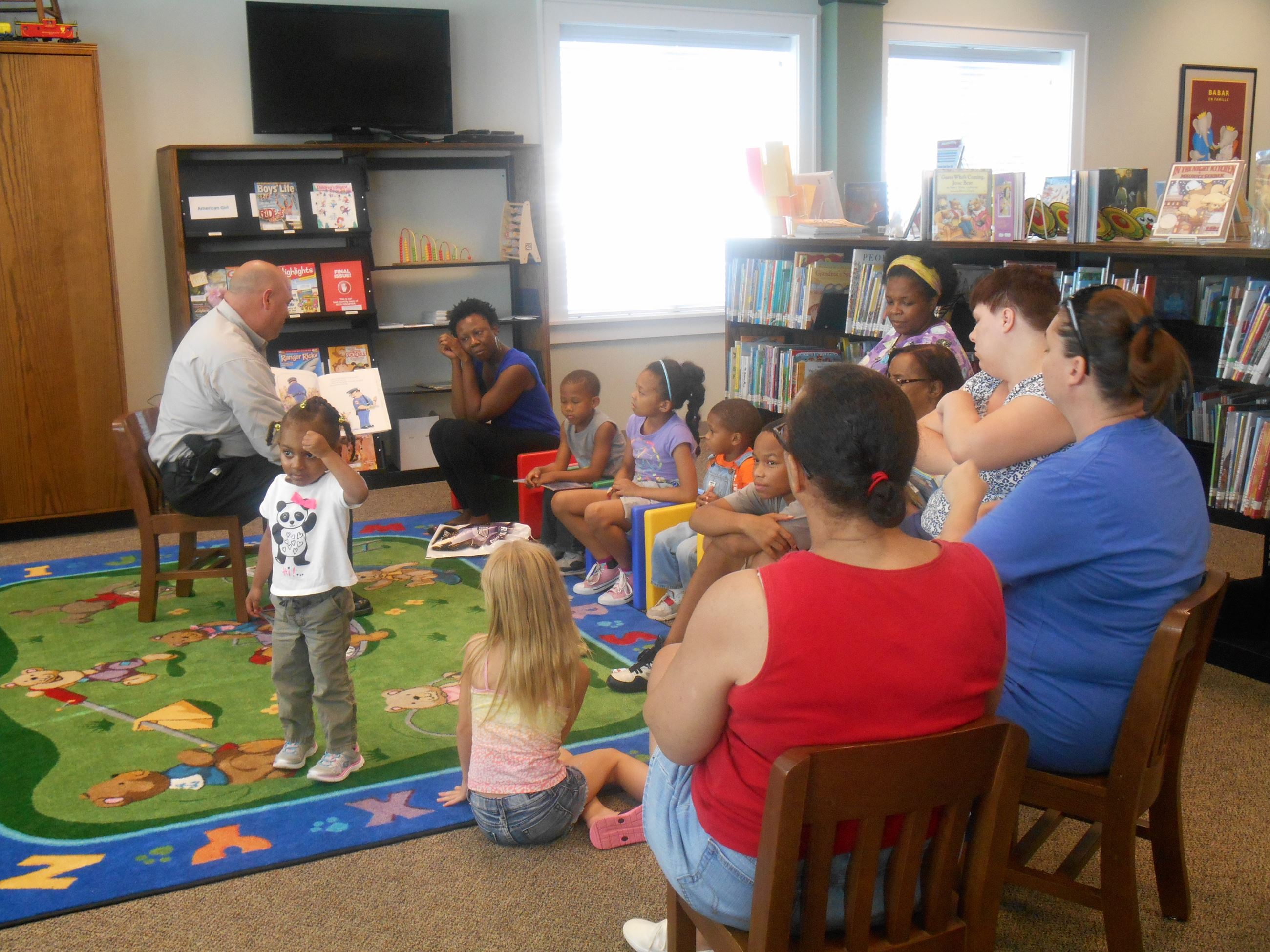 Police Officer reading to children