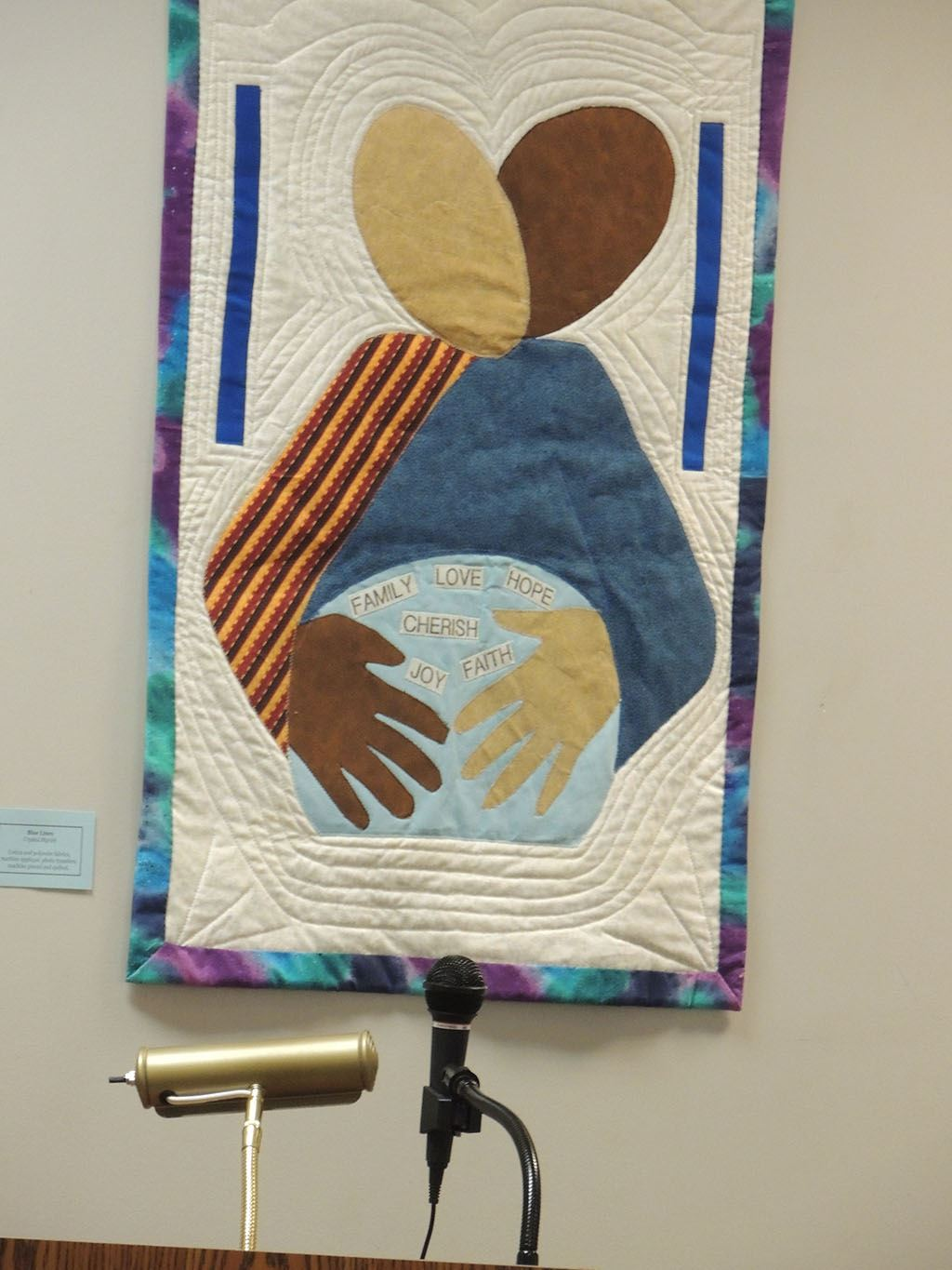 Quilt of two people holding each other