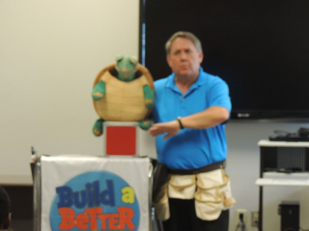 Man holding turtle puppet