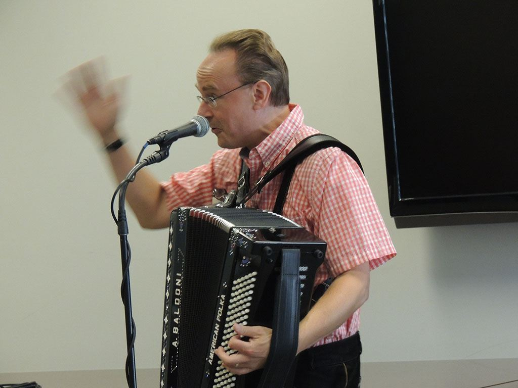 Polka man speaking