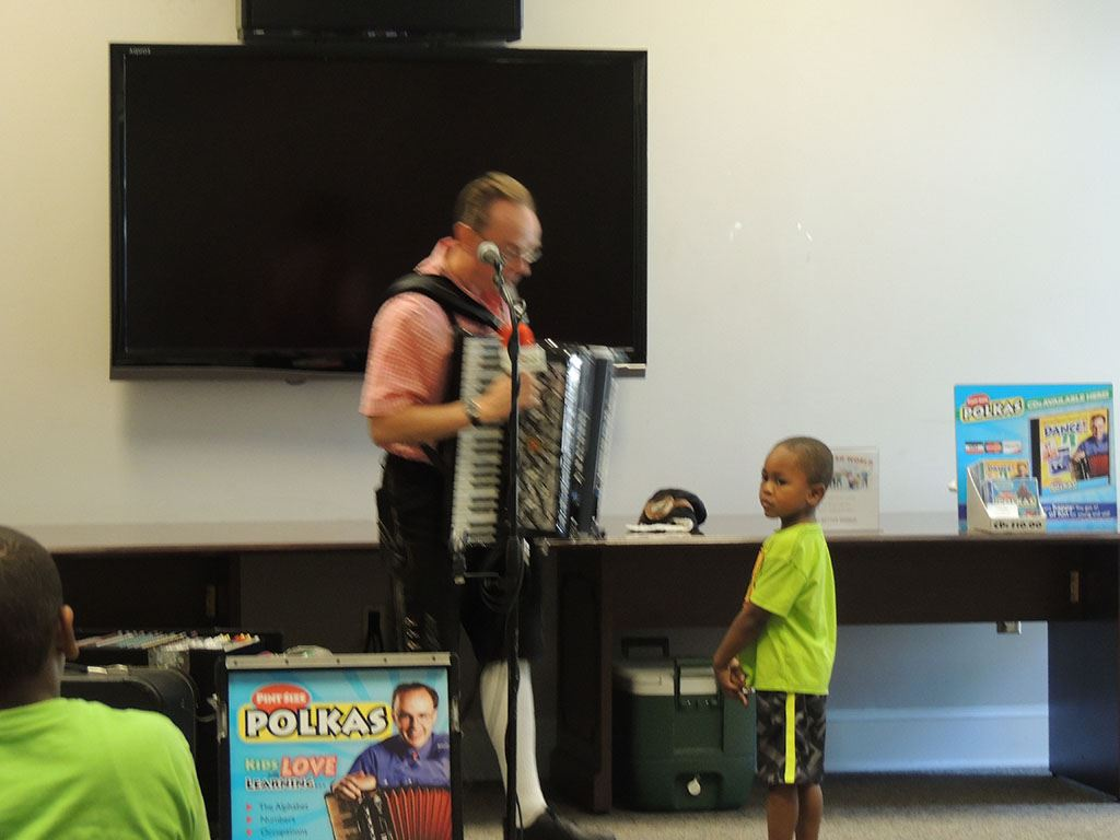 Polka Man talking with young boy
