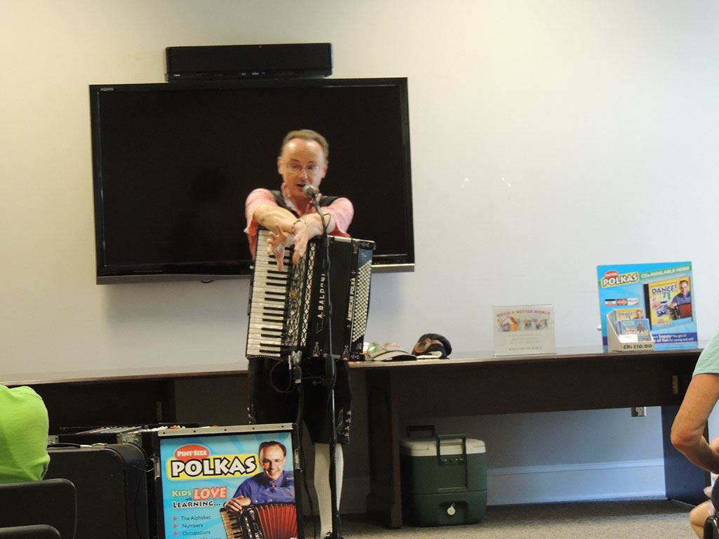 Polka man with accordion at microphone