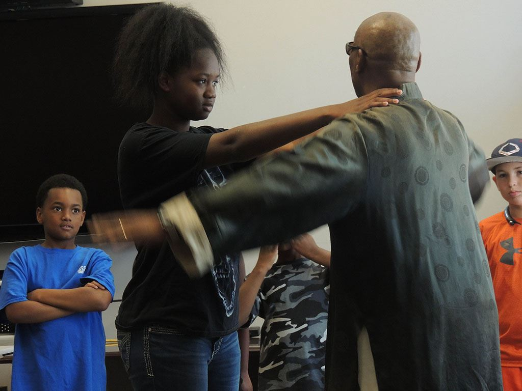 Master Bobby Scott demonstrating with help of woman