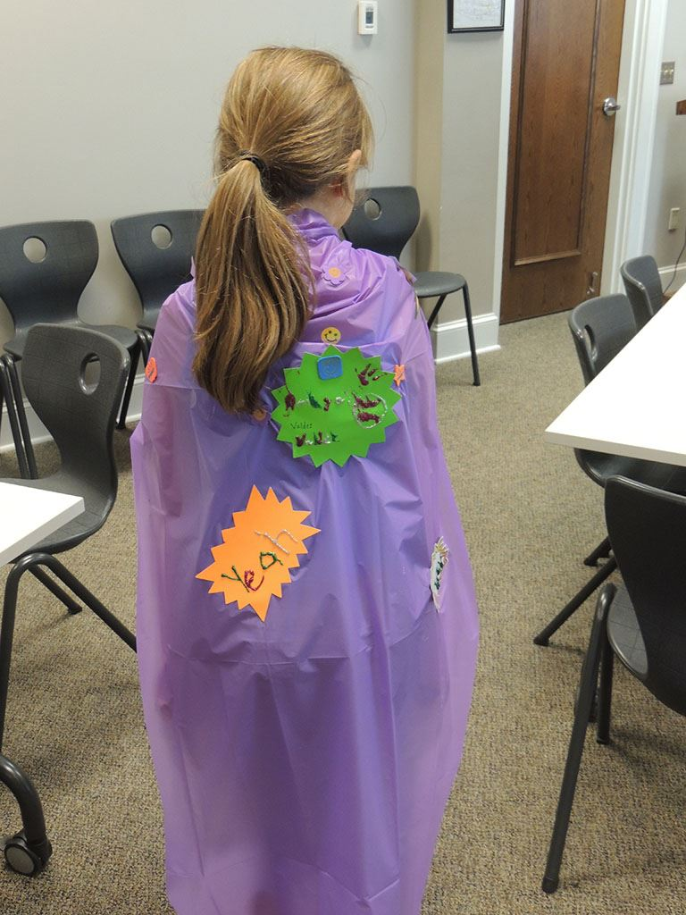 Girl wearing purple cape