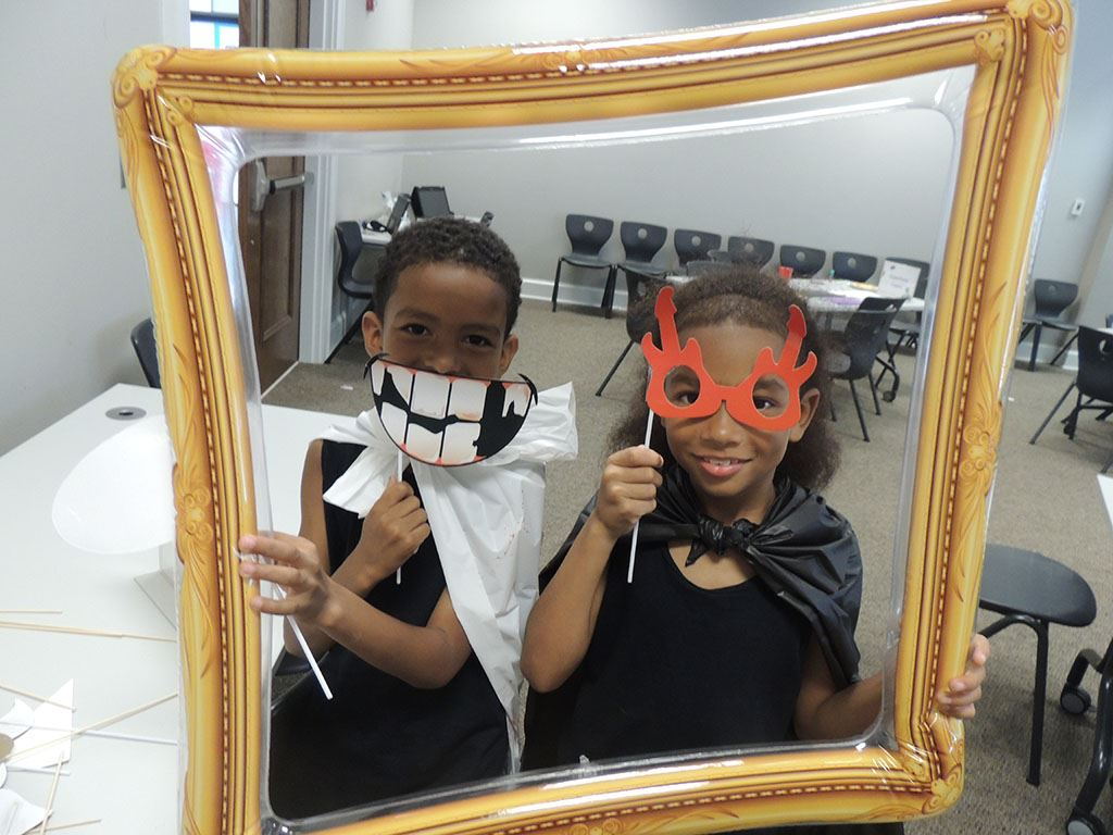 Two children standing in selfie frame