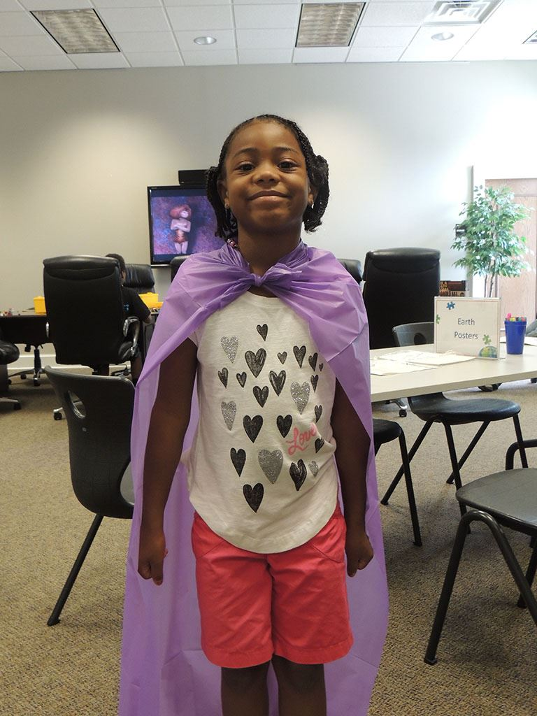 Girl in purple cape