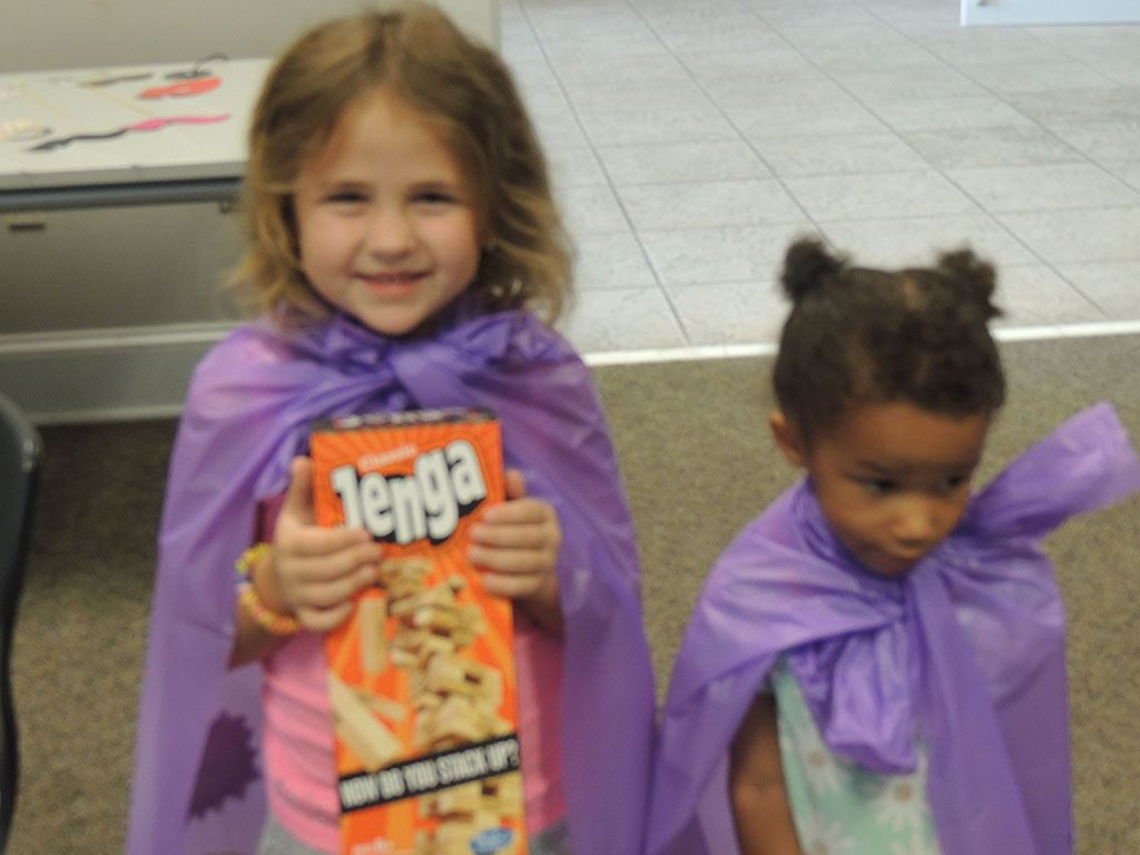 Girls in purple capes