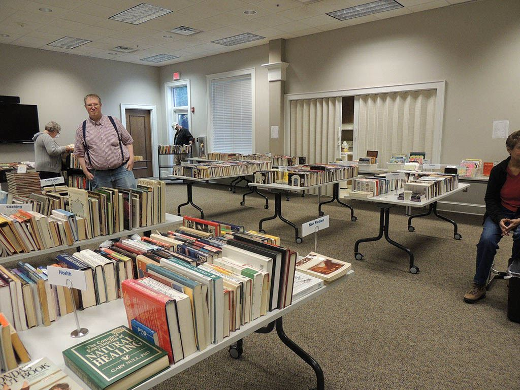 Room filled with tables of books and people