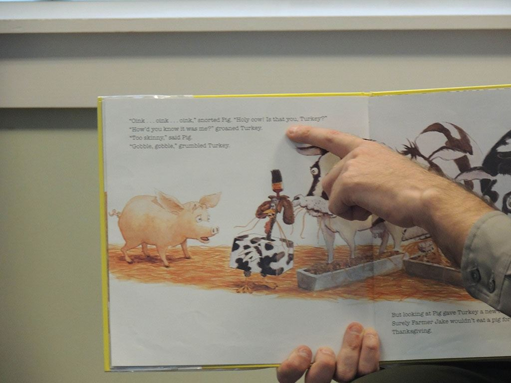 Man pointing to page in book